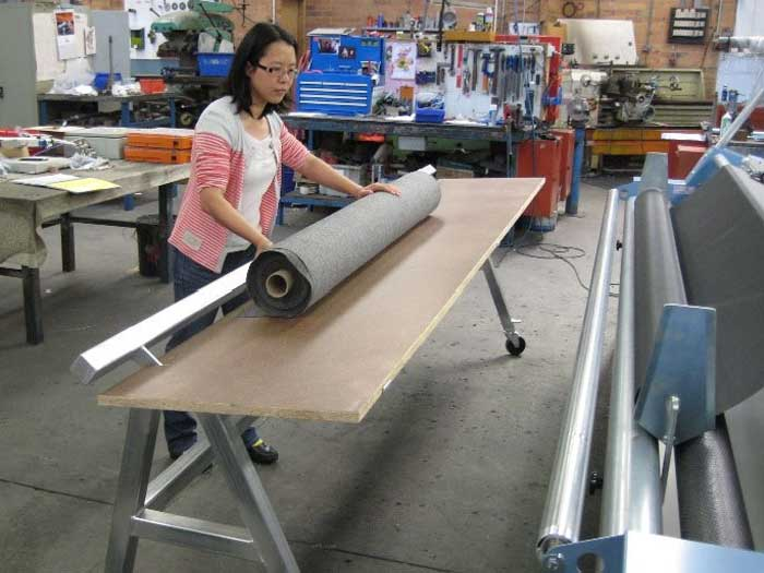 Doffing table for loading heavy rolls on and off the Alpha 3 machine.