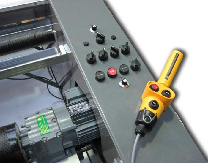 Integrated control panel showing AC drive motor and remote control