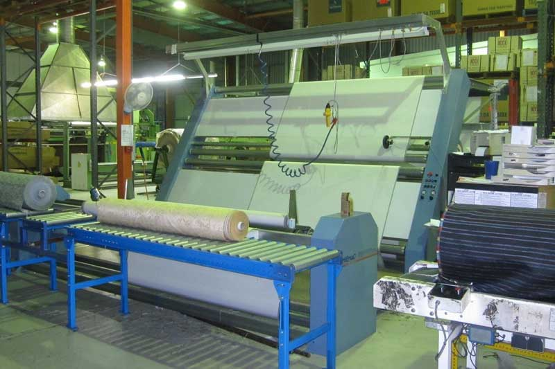 Delta 3 machine with rear roll up, inspected rolls entering plastic wrapping tunnel. Dual sided inspecting being used.