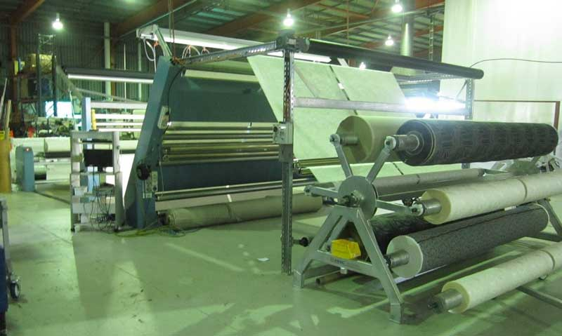 Delta 3 machine inline being fed from powered 6-roll spi-der frame carrying loom rolls.